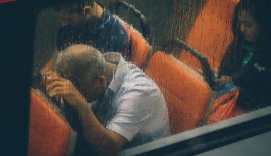 man stressed on bus
