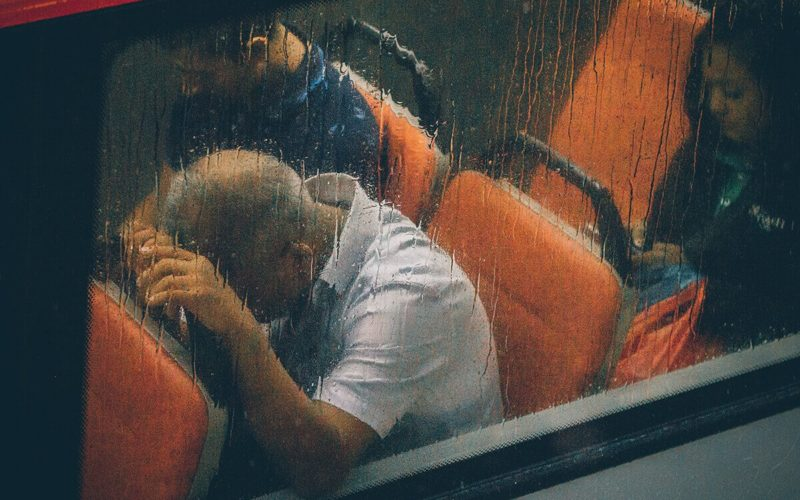 man stressed on bus