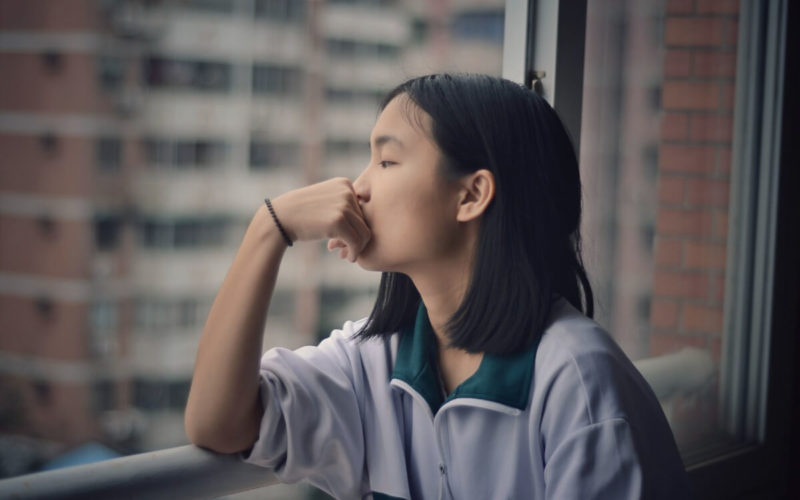 girl practicing introspection by window