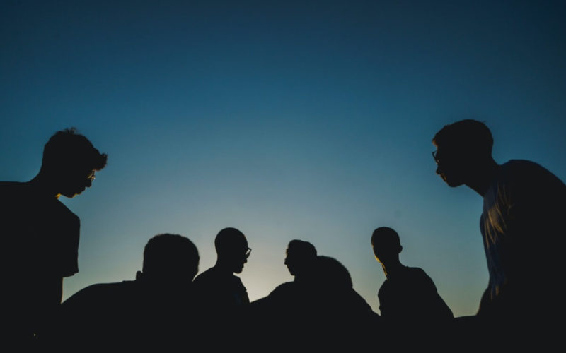 silhouette of people sitting