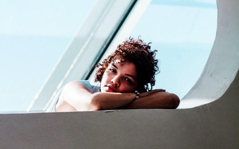 girl leaning on window, surreal scene