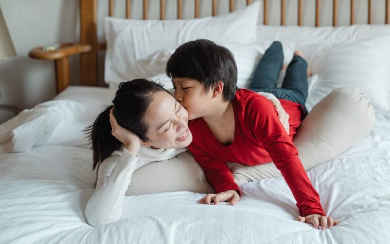 mother and son on bed