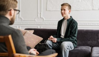 young man speaking to therapist