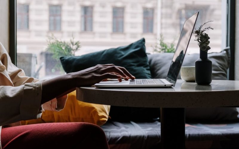 person typing on laptop