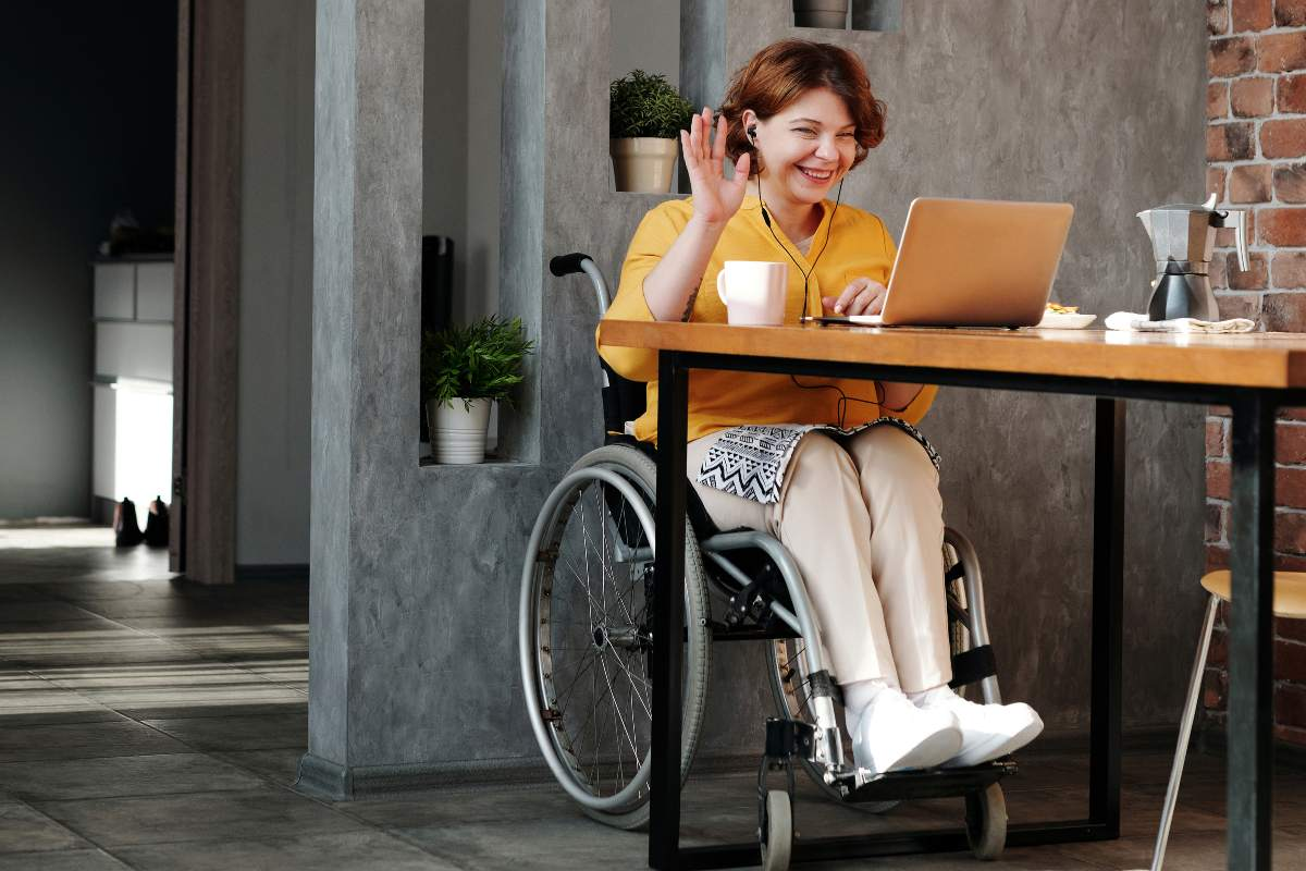 lady in a wheelchair participating in a video conference