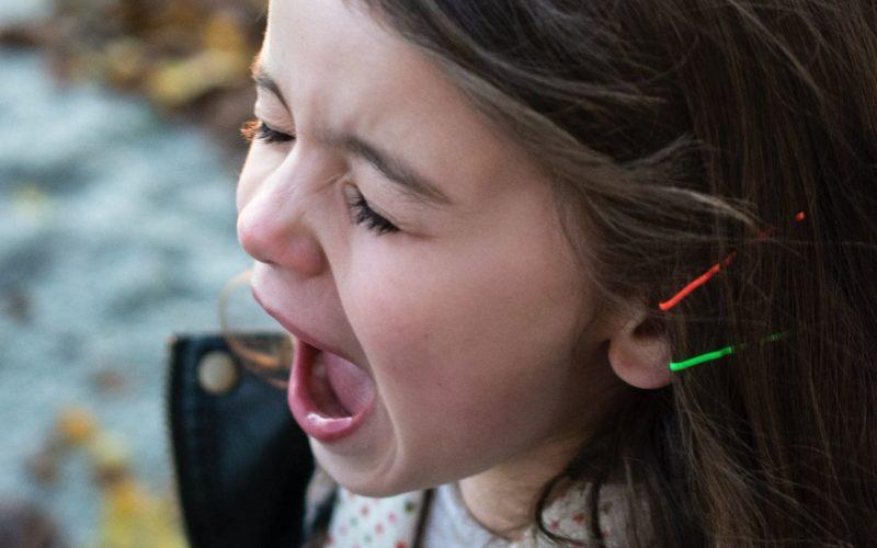 little girl screaming in anger