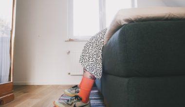 woman lying on sofa