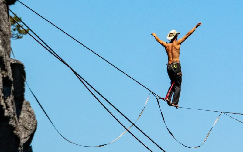 Guy balancing on a high rope