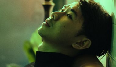 Man gazing towards the void through green light