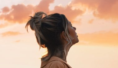 woman looking out at sunset