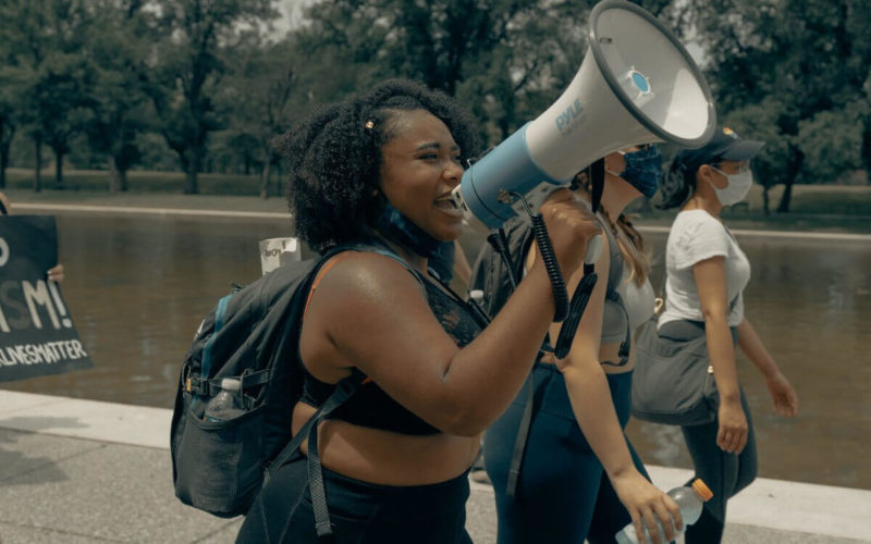 black woman with megaphone black history month