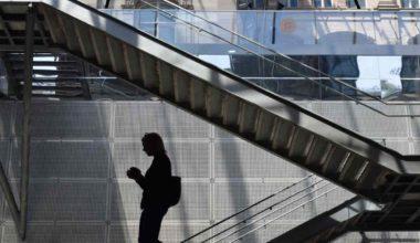 woman descending down a staircase