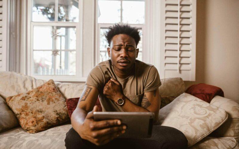 sad man looking at iPad