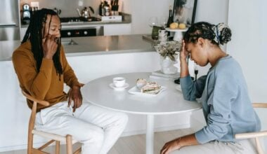 man and woman sitting at table and not eating