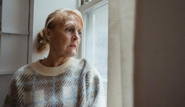 eldery woman looking out of window